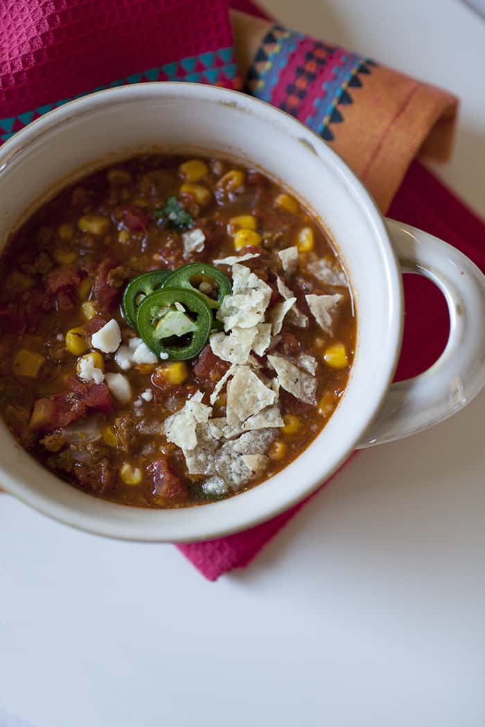 This taco soup recipe is packed with flavor and perfect for busy nights when you need a quick one pot meal! Throw the ingredients in and cook for 30 minutes.
