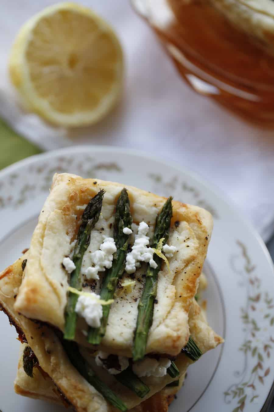 This asparagus ricotta puff pastry tart is a perfect side dish or appetizer for a spring or summer tea party!