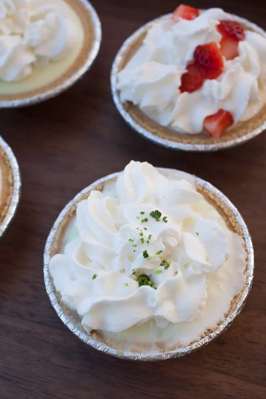 These quick, no bake whipped cream pies are the perfect way to serve dessert this summer! Try these three easy recipes for key lime cream pie, strawberries and cream pie, and coconut pineapple cream pie.