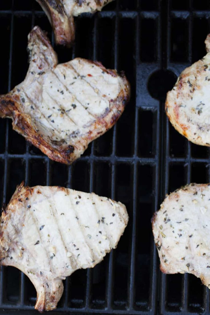 If you need an easy weeknight dinner that will get dinner on the table in a hurry, these easy grilled pork chops are so easy! Plus this homemade Italian marinade will become your go to marinade for grilled meats and veggies.