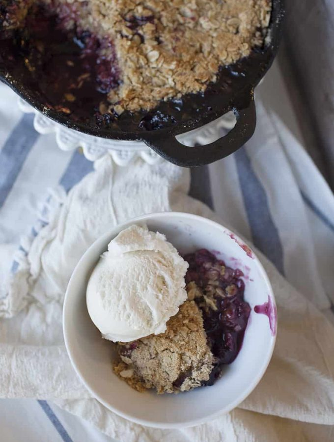 This cast iron mixed berry crisp is the perfect quick dessert! You can easily sub out the fruit for whatever you have on hand for a delicious after-dinner treat!