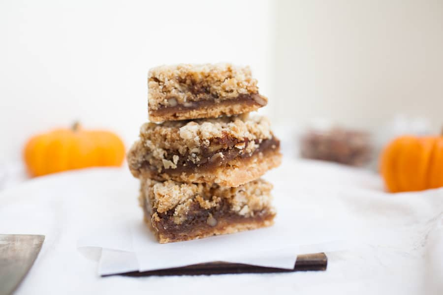 These pecan pie crumble bars are perfect for the holidays or when you need a little holiday spirit any time of the year! These bars have a shortbread pie like crust, gooey pecan pie filling, and the easiest crumble topping.