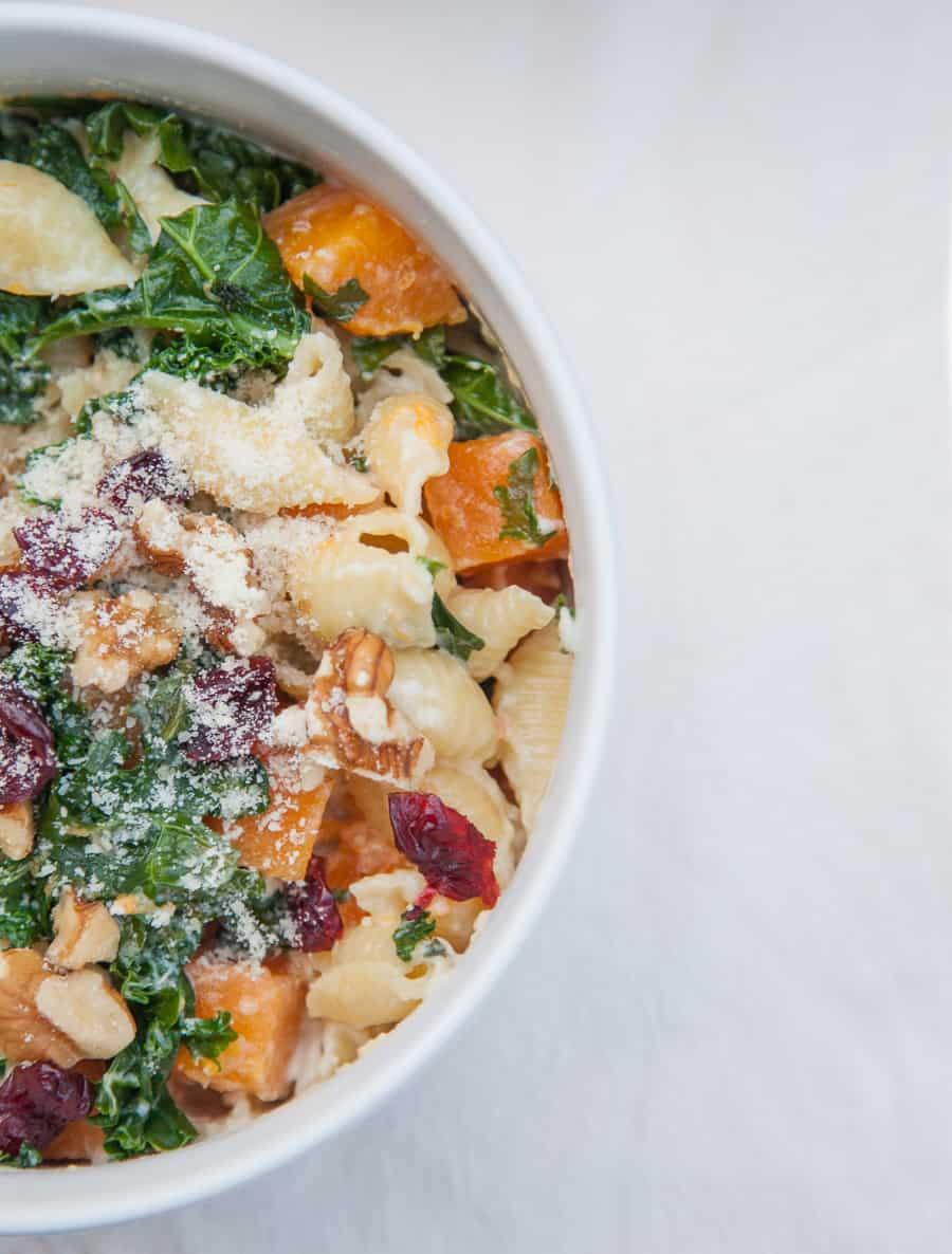 Celebrate this season by sharing this Creamy Butternut Squash Kale Pasta with friends and family! This pasta is surprisingly light but packed with winter flavors like fresh butternut squash, kale, cranberries and chopped walnuts. This is a pasta dish that is perfect to share and sure to impress!