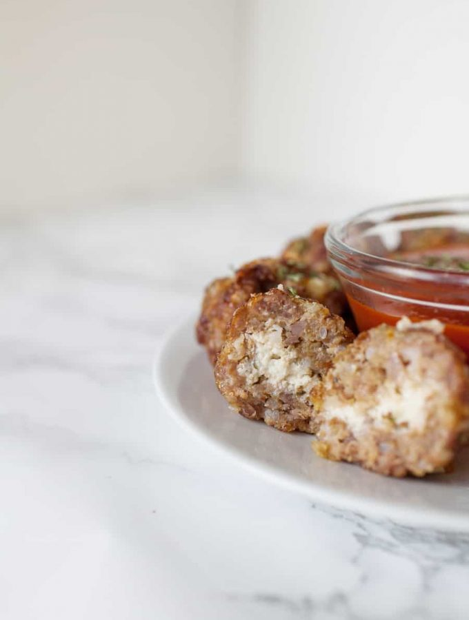 Looking for a quick and easy appetizer for the Big Game? These ricotta stuffed sausage meatballs are so easy to make. Your football friends will go wild for these quick baked ricotta stuffed sausage meatballs at your Big Game party! party food   meatballs from scratch   meatball recipes   meatballs   appetizer recipes   superbowl party food   football food