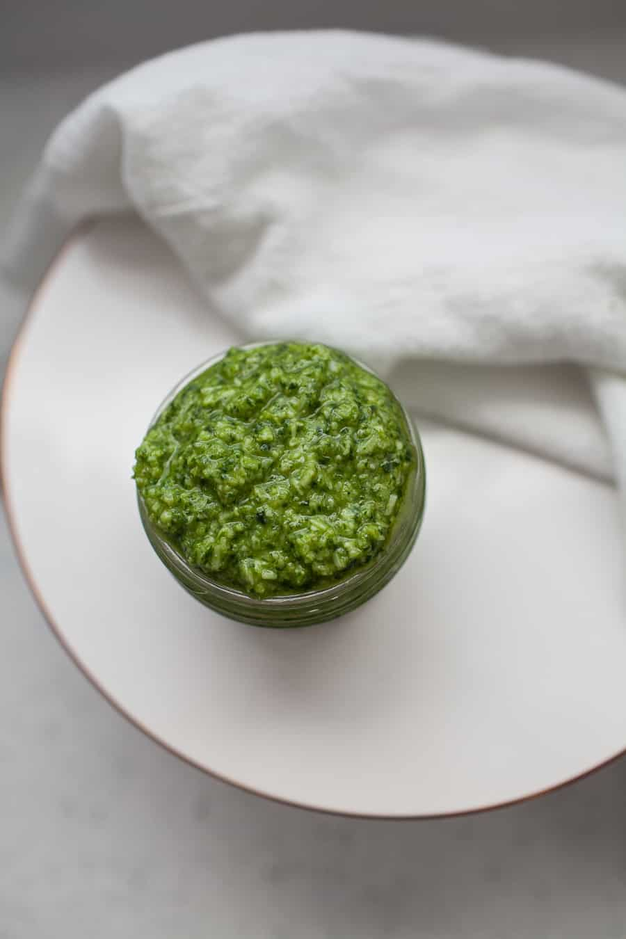 If you're a pesto fan, you're going to fall even more in love with pesto once you realize how easy it is to make it homemade! This homemade kale arugula pesto variation is a perfect peppery, smooth blend of pesto that you'll choose every time. Make this kale arugula pesto ASAP! homemade pesto   arugula pesto   kale pesto   kale arugula pesto   homemade italian sauces   homemade pasta sauce   pasta sauce recipes