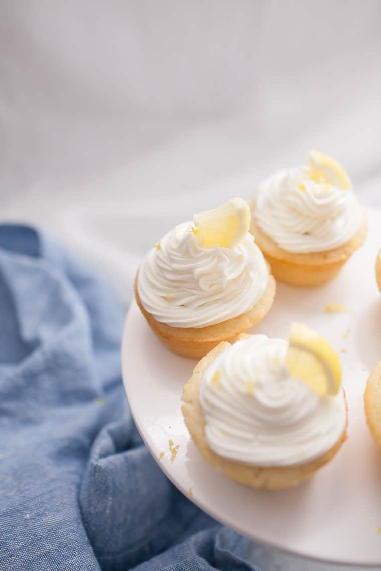 Double lemon cupcakes made with a lemon buttercream icing will be your favorite new cupcake recipe! Made in under 30 minutes and serves 12 cupcakes. You'll love how fluffy, moist and fresh these lemon cupcakes are.