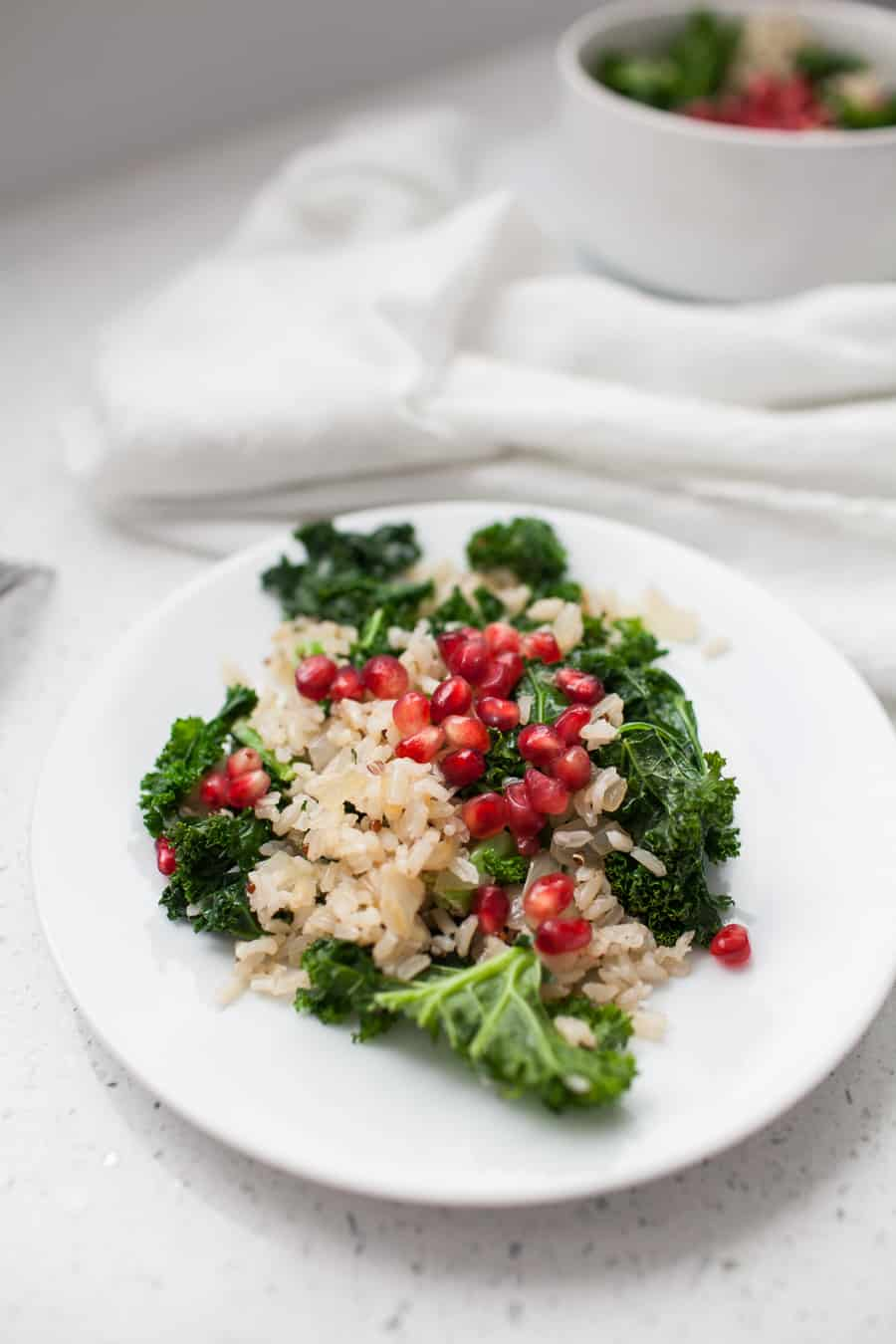 This salad takes less than 10 minutes to make and the flavors are perfectly light and simple for springtime. A Spring Pomegranate Brown Rice Kale Salad is the perfect addition to any spring meal. spring salads | pomegranate recipes | kale salad recipes | kale salad | kale spring salad | rice salad | brown rice salad | brown rice and kale recipes