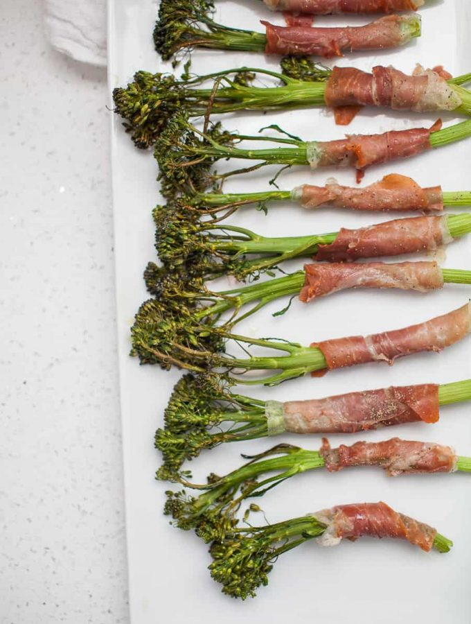 Prosciutto wrapped broccolini is the perfect side for pretty much any dinner! It's fancy, but incredibly simple to make with only two ingredients. Take 15 minutes to make this delicious side dish for dinner ASAP.