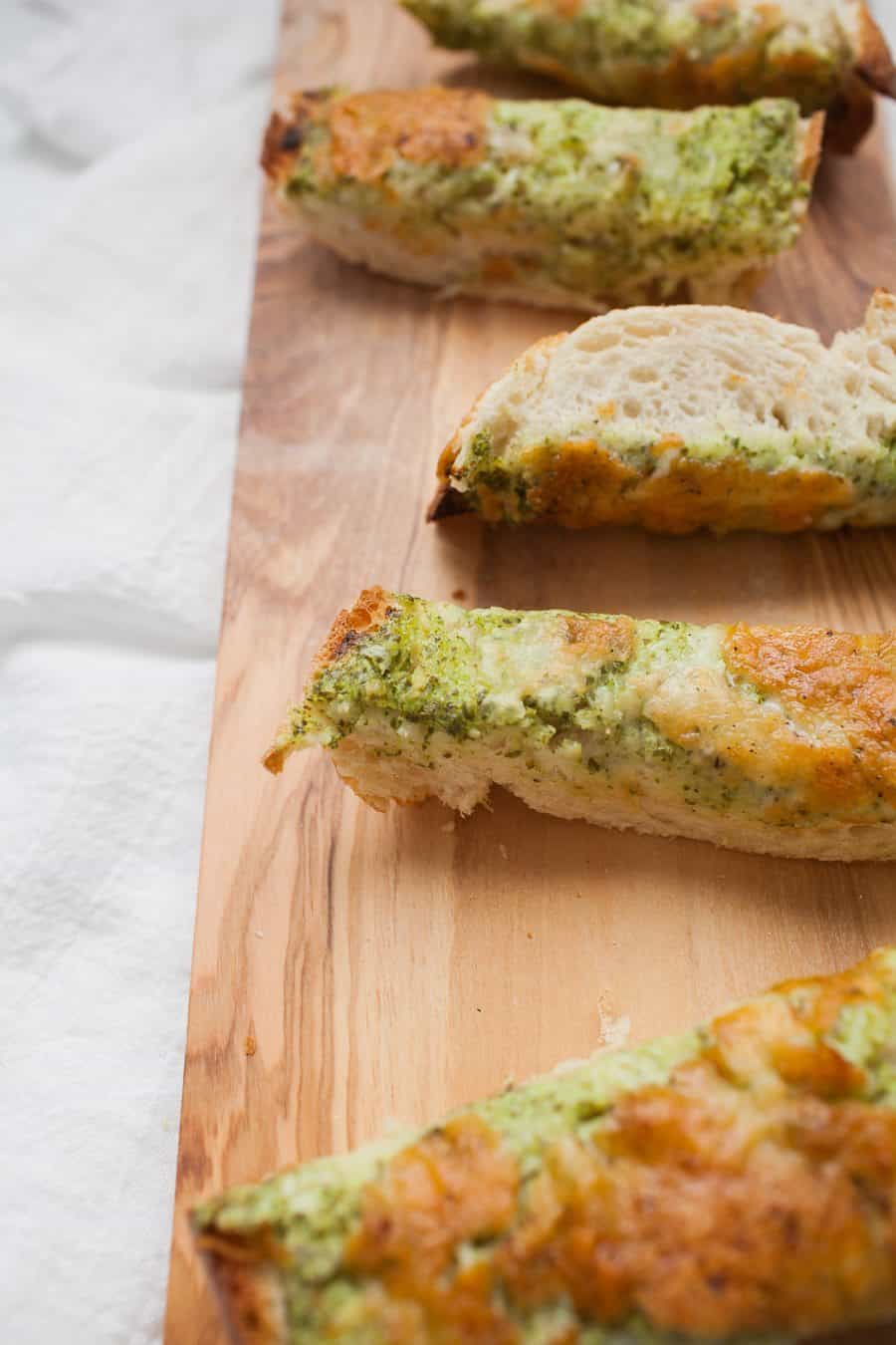 Cheesy Ranch French Bread makes a perfect pre-dinner appetizer! It's great for a crowd or just for your family while dinner finishes cooking. Made with homemade ranch dressing, this french bread is packed with fresh ingredients and will make the wait for dinner much more enjoyable.