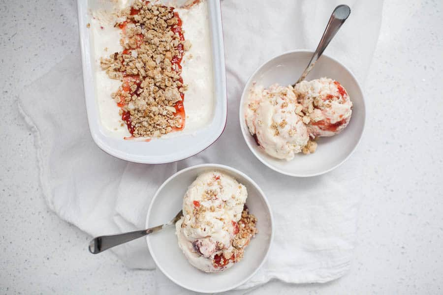 Summer is the perfect time for ice cream! If you don't have an ice cream machine, have no fear, this no churn ice cream recipe requires onlyfour ingredients for a light and delicious summer treat. Celebrate National Ice Cream Day with this Strawberry Granola Parfait No Churn Ice Cream!