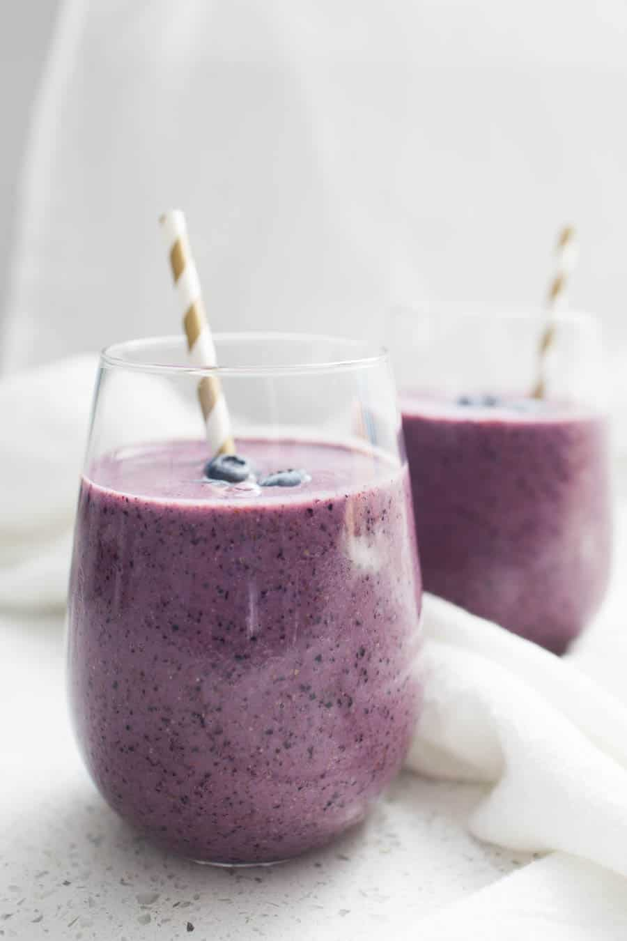 Smoothies are the perfect breakfast or snack to pack in tons of flavor and protein! Made with frozen blueberries, plain greek yogurt, spinach, flax seed and sweetened with a pinch of honey, this Blueberry Greek Yogurt Smoothie is perfect for the whole family.