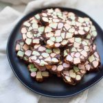No Bake Stained Glass Window Cookies are made with melted butter butter and chocolate chips plus colorful mini marshmallows. The mixture is rolled into logs and sliced into one inch thick cookies. This quick recipes makes enough for a crowd so this recipe is perfect for all of your holiday gatherings!