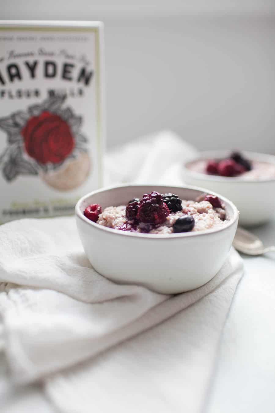 Quick breakfasts are a must! This triple berry stovetop porridge is the perfect breakfast to make in the morning or prep ahead for the week! Your whole family will enjoy this hot breakfast that is refined sugar free, dairy free, yet creamy and delicious. Made with Hayden Mills Farmer's Porridge, almond milk, frozen mixed berries and a splash of pure maple syrup, this stovetop porridge will start your day off right!