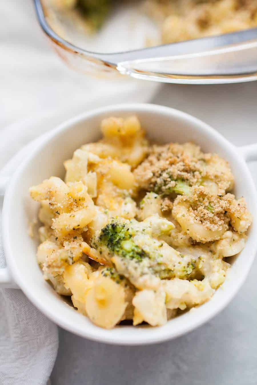 Homemade baked macaroni and cheese is a recipe every one should know how to make! If you enjoy eating mac and cheese, and who doesn't, this is a recipe you've got to try! It's perfect for weeknight dinners, bringing to a friend, or serving to the whole family! This homemade broccoli macaroni and cheese is made with corkscrew pasta, homemade cheese sauce, broccoli and finished with a bread crumb topping.