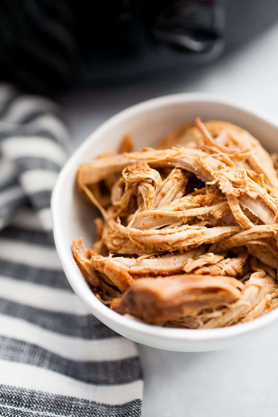 Slow cooker pulled pork is a classic! If you're looking for a healthier, refined sugar free version to make your entire family, this is it. Made with coconut sugar, spices, chicken broth and a dash of soy sauce, thisRefined Sugar Free Slow Cooker Pulled Pork can be thrown in the slow cooker in the morning and enjoyed with the whole family for dinner. This recipe also makes tons of leftovers for enjoying a second or third time around!