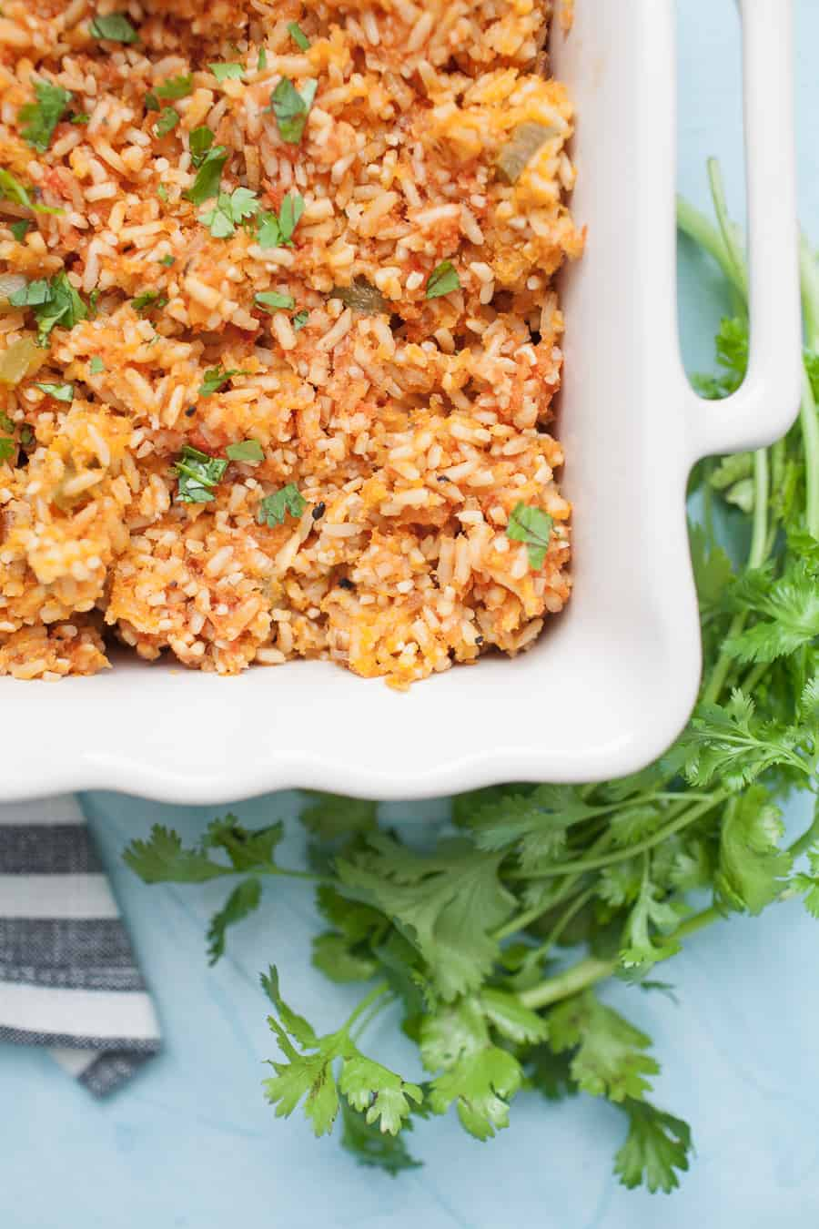 If you love Mexican food but want that restaurant quality food at home, this Traditional Mexican Rice is for you! This recipe is easy to make and bakes in the oven, which locks in the flavor and moisture that makes this recipe so delicious. You'll never go back to eating Mexican rice any other way!