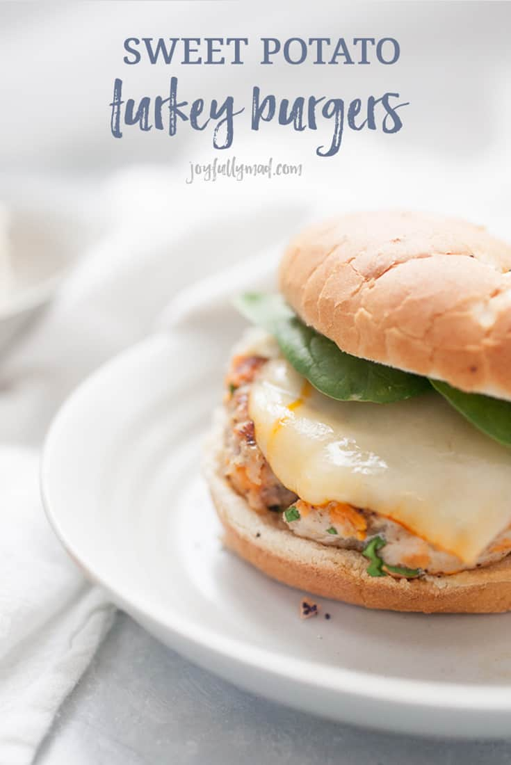 Homemade burgers are so easy to make and the taste can't be beat! This quick recipe is perfect for dinner on the table in under 30 minutes. These homemade sweet potato turkey burgers are made with spinach, sweet potatoes, ground turkey, and spices and topped with cheese on an onion bun. It's such a simple burger but packed full of flavor!