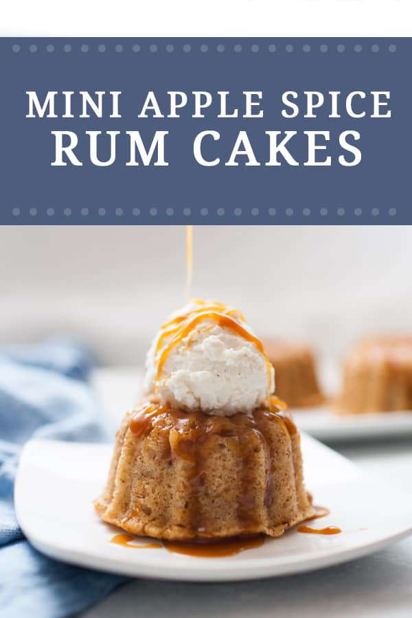 Pouring caramel sauce over mini bundt cakes topped with vanilla ice cream with a spoon.