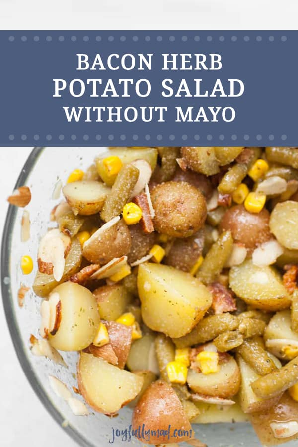 This quick potato salad without mayo is perfect for any time of year. It can be served warm or cold! This herb potato salad features red potatoes, bacon, green beans, corn, sliced almonds and a dressing that has olive oil, red wine vinegar and herbs. This light side dish is perfect for so many gatherings!
