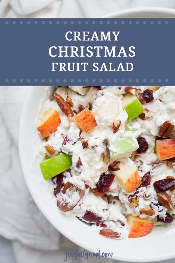 Creamy Christmas Fruit Salad is the perfect side dish for your holiday dinner! Your family will love this winter fruit salad with heavy whipping cream, apples, cranberries, grapes, bananas and pecans.