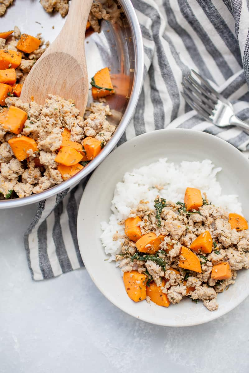 Stainless steel skillet with sweet potato and ground turkey mixture. Gray plate with sweet potatoes, ground turkey and rice.