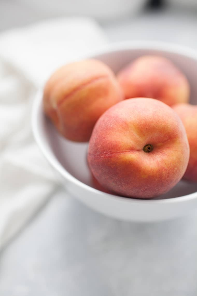 Bowl of ripe peaches.